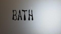 Hunajakoto, sign in bathroom door